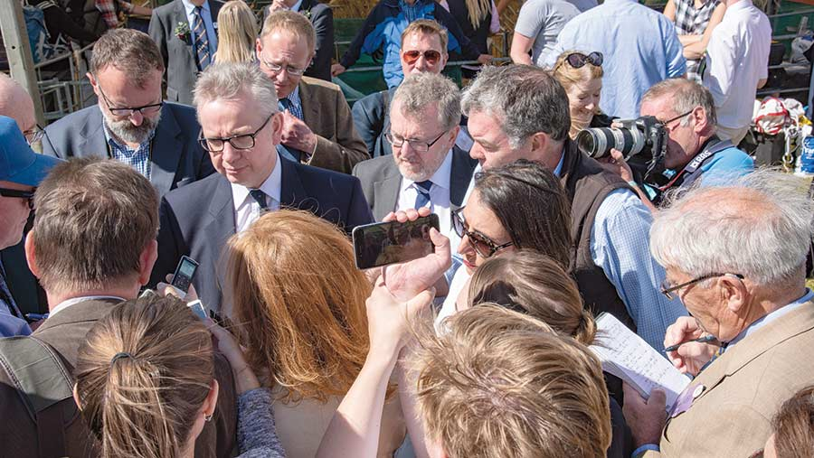 Michael Gove is surrounded by journalists