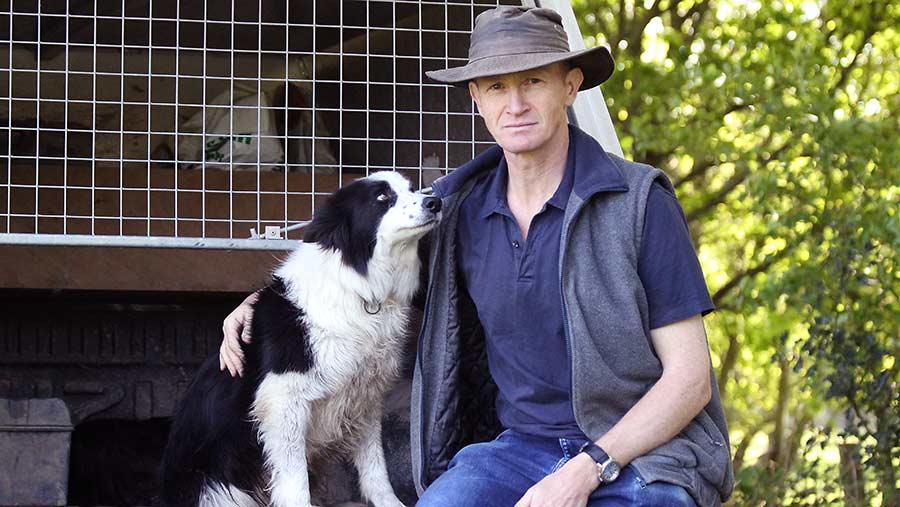 Tobin Bird sits with his collie