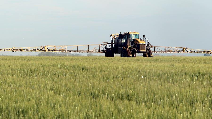 Self-propelled sprayer on a Canadian field