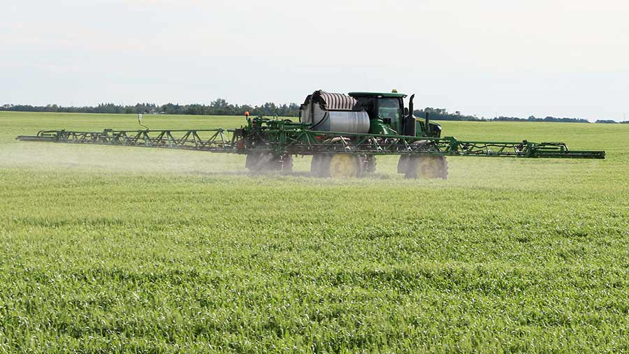 A larger sprayer in a field