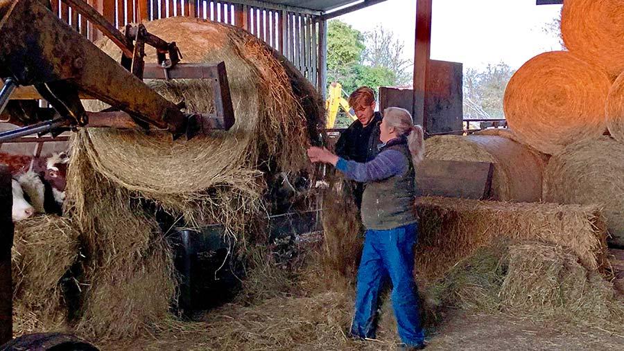 Rufus helps mum Sarah Denne on the farm © Oli Hill/RBI