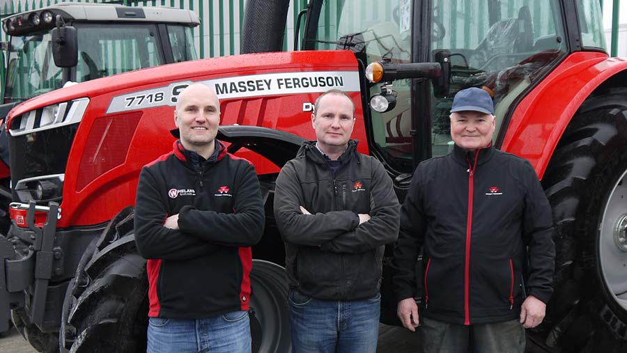 Three men lined up with a Massey Ferguson tractor