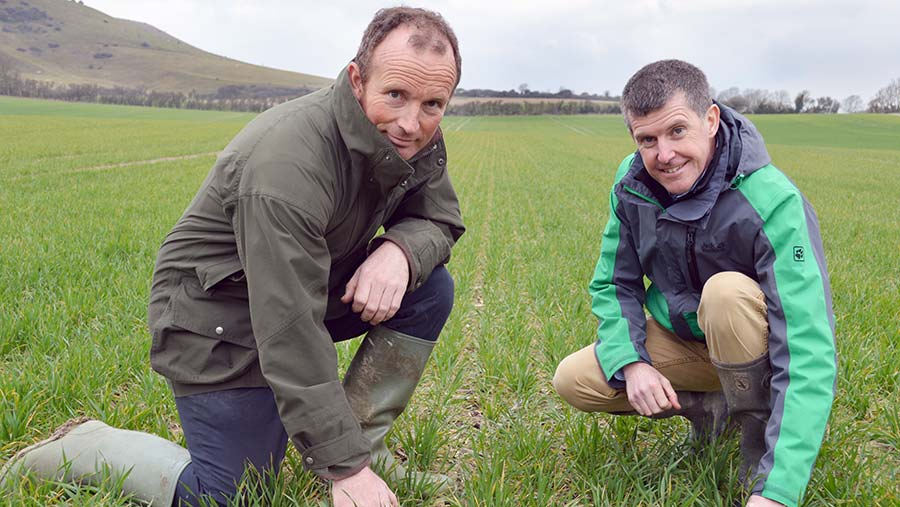 Will Hecks (left) and Mike Thornton kneeling in a field