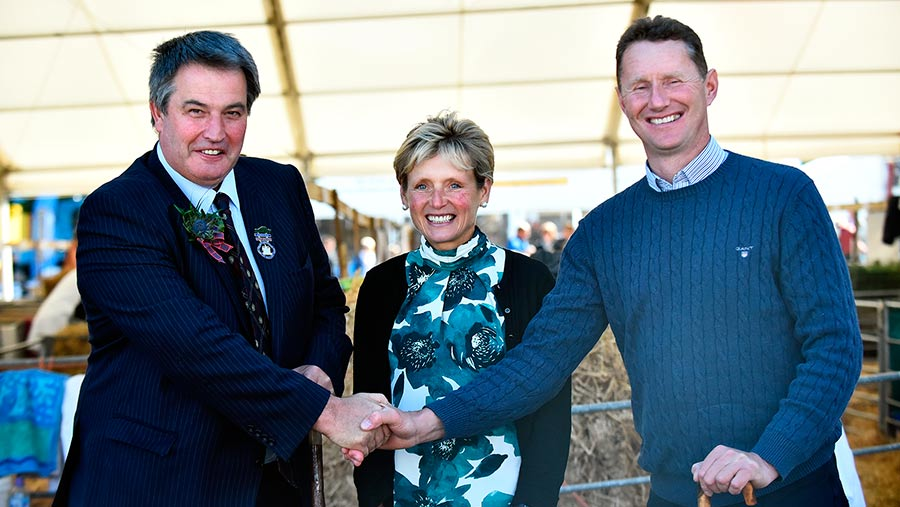 John Hamilton, left, presents the Sir William Young Award to Patsy and Ian Hunter at the 2018 RHS © RHASS
