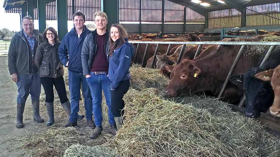 Kemp family in their cow shed