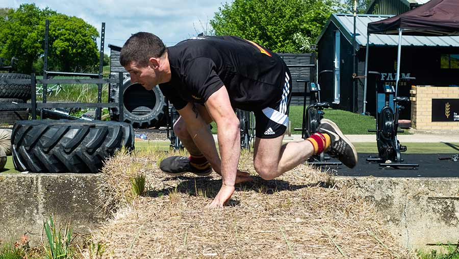 Michael Osborne leaps over a straw bale at the 2019 Britain's Fittest Farmer final
