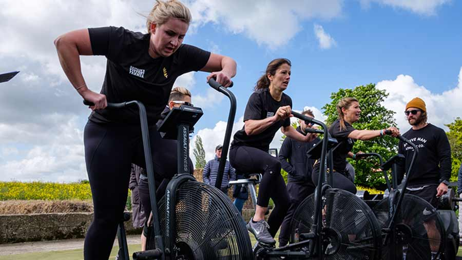 From left: Sarah Phillips, Jemma Harding and Claire Moreton dig deep on the assault bikes © Colin Miller/RBI