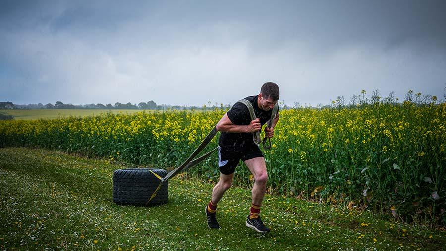 Manx man Michael Osborne towing his tyre © Colin Miller/RBI