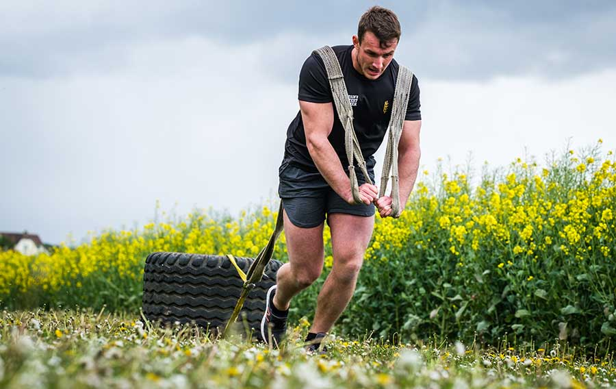 James Duerden powers on with tyre in tow at the 2019 Britain's fittest farmer final