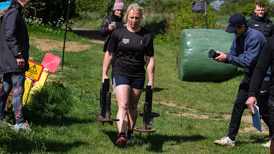 Fiona Penfold tackles the farmer's walk with the 2019 Britain's Fittest Farmer Final