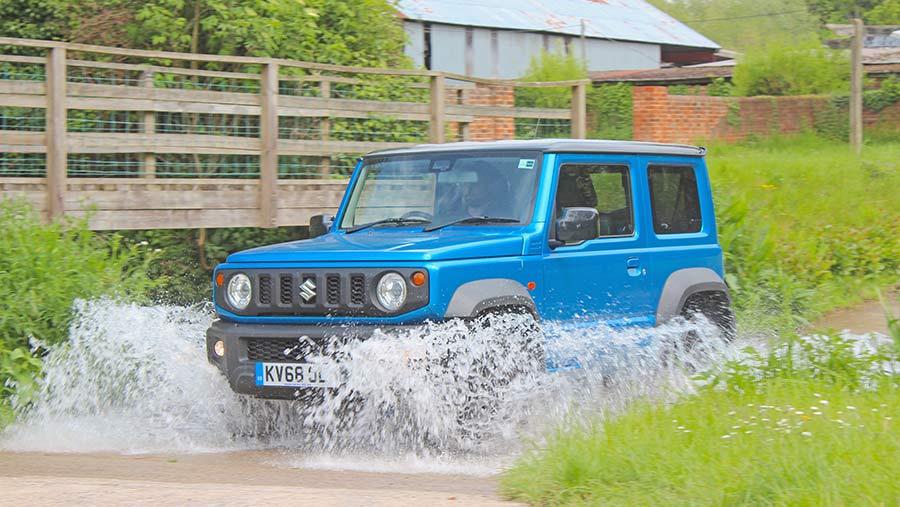 Suzuki Jimny driving through water