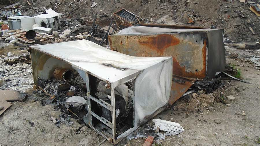 A pile of burnt-out fridges on Brian Rutterford's farm