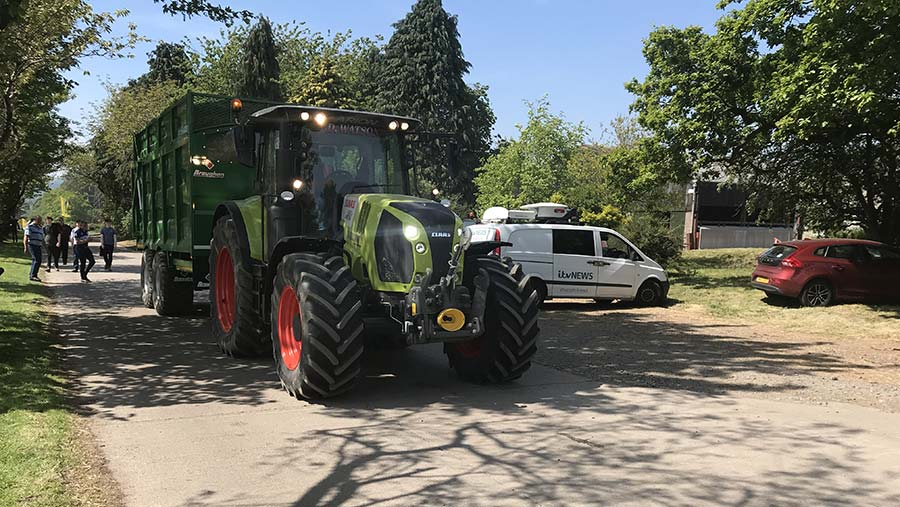 Claas Arion taking grass to the clamp