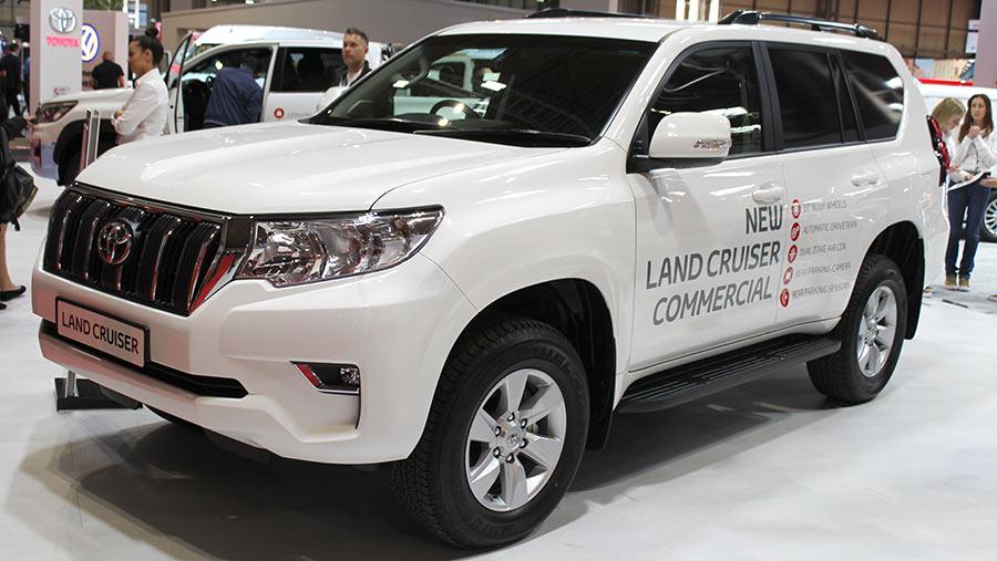A white pickup at a car show
