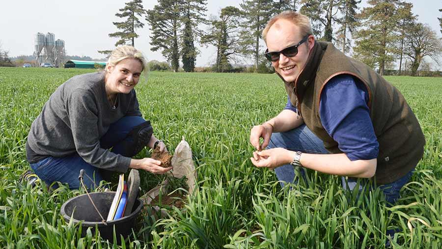Jackie Stroud and Simon Eddell kneeling in field