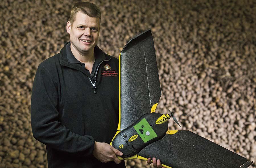 Dutch farmer Jacob Van den Borne holds a drone aircraft