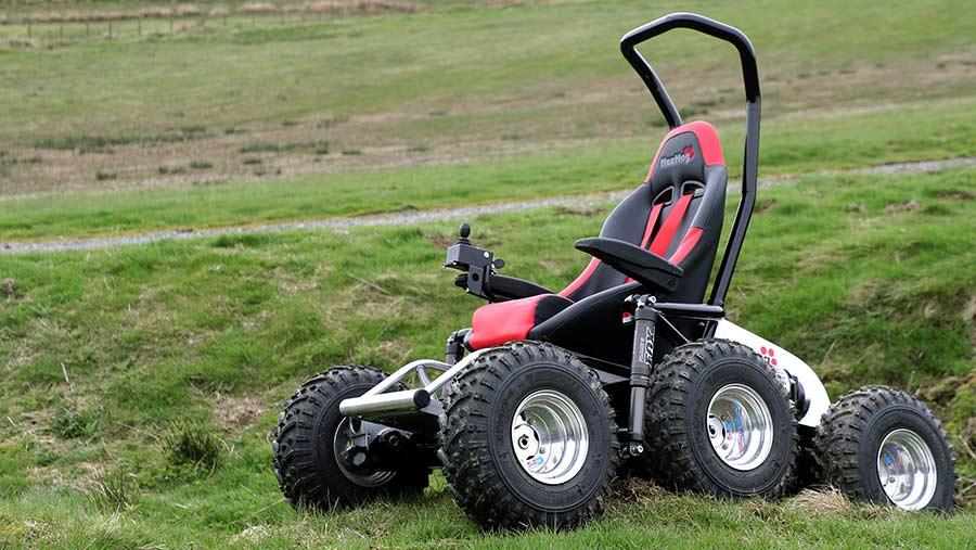 All terrain wheelchair in a bumpy field