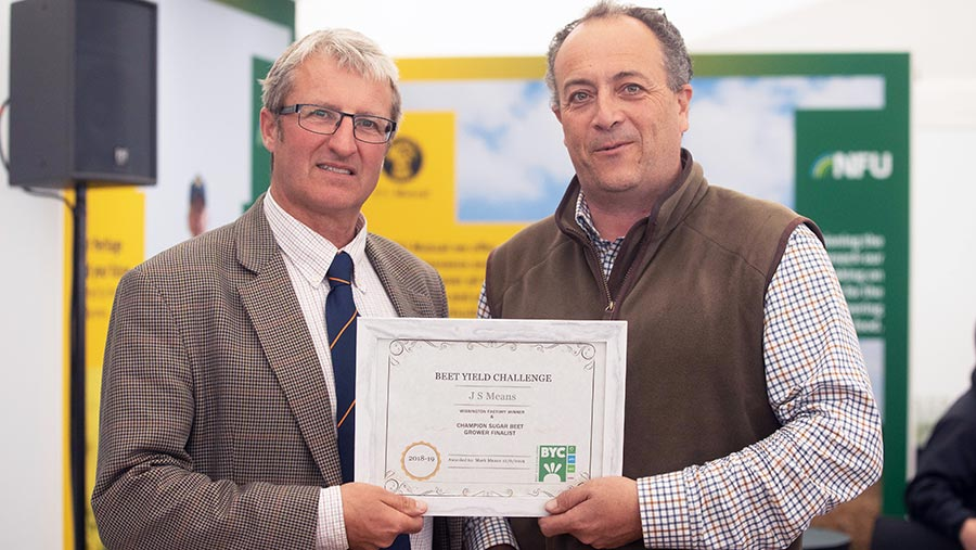 Darryl Shailes (left) of Hutchinsons presents Mark Means with his award © Tim Scrivener