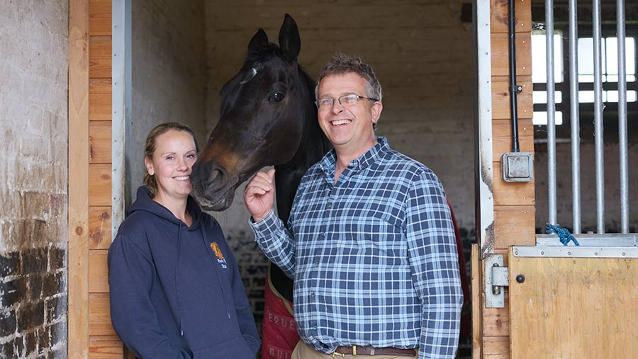 Vicki Stock and James Seller in stable with horse
