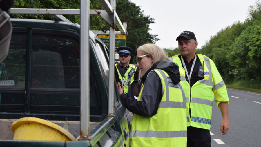 Police and council staff checking a vehicle near Ripon © North Yorkshire Police