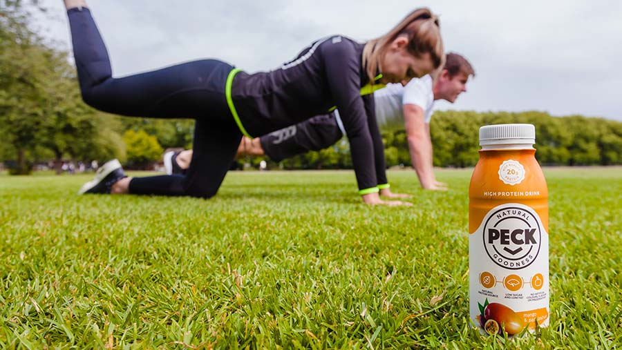 Fitness couple with Peck drink