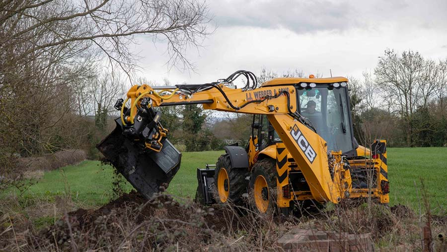 JCB digger with Tiltrotator attachment