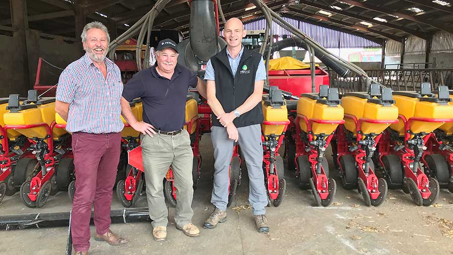 Martin Smart, centre, and Paul Gruber, right, with agronomist Gavin Moss in front of the Vaderstad