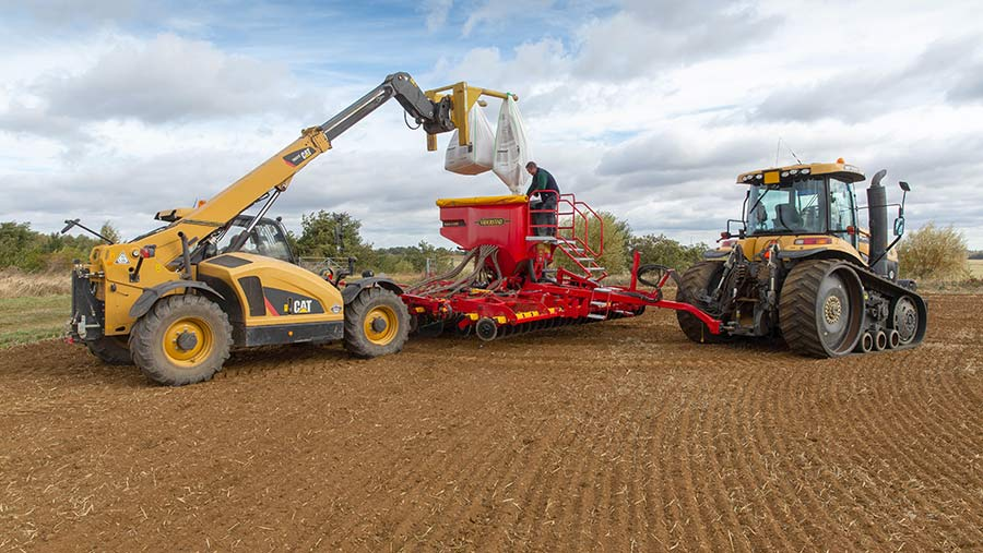 Filling seed drill with wheat