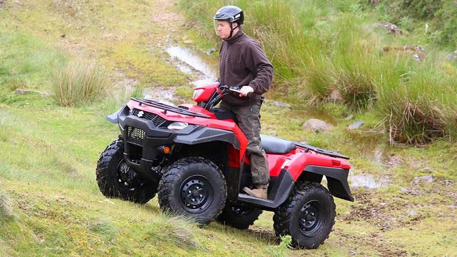 Rider standing up on Suzuki King Quad