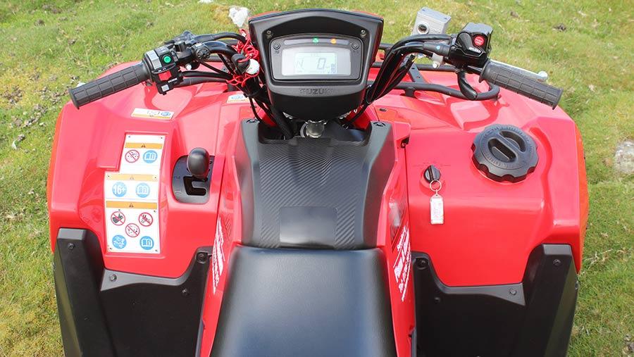 Handlebars and controls of Suzuki King Quad