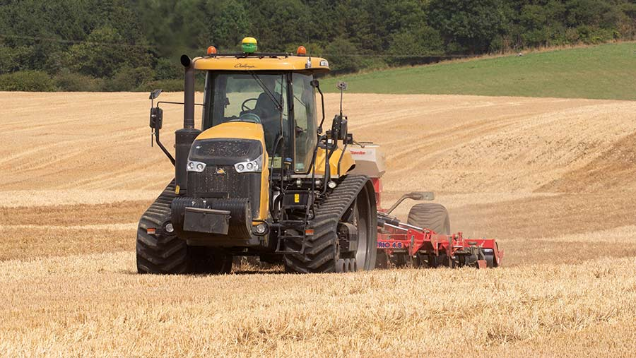 Tractor in field cultivating stubble