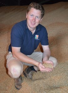 Farmer Alan Clifton Holt in his grain store