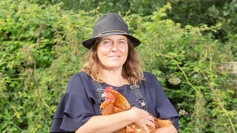 Susie Macmillan holding a chicken