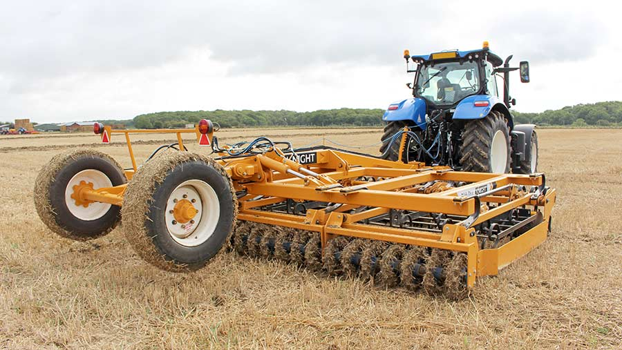 A tractor and drill working in a field