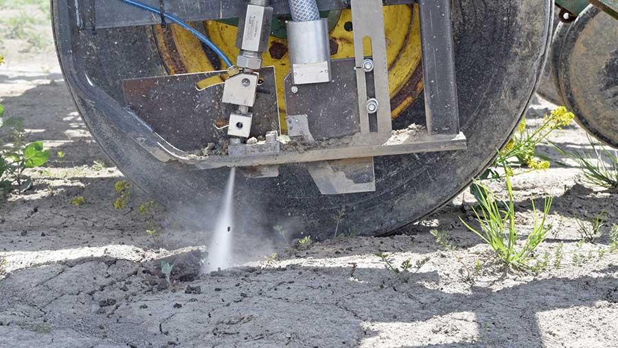 Water jet spraying ground