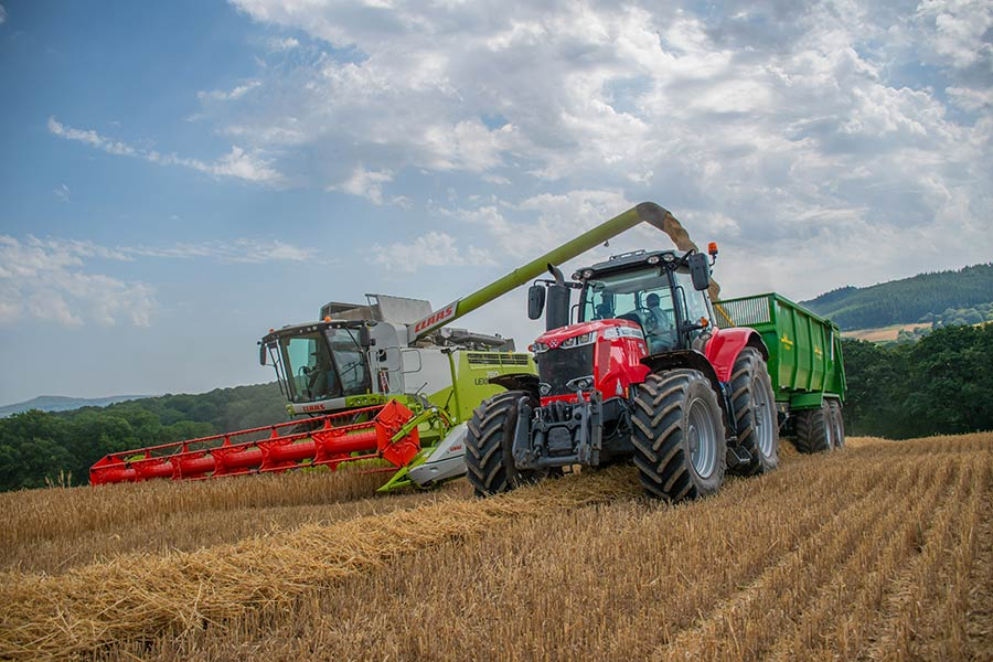Combine and tractor by Zak Mumford