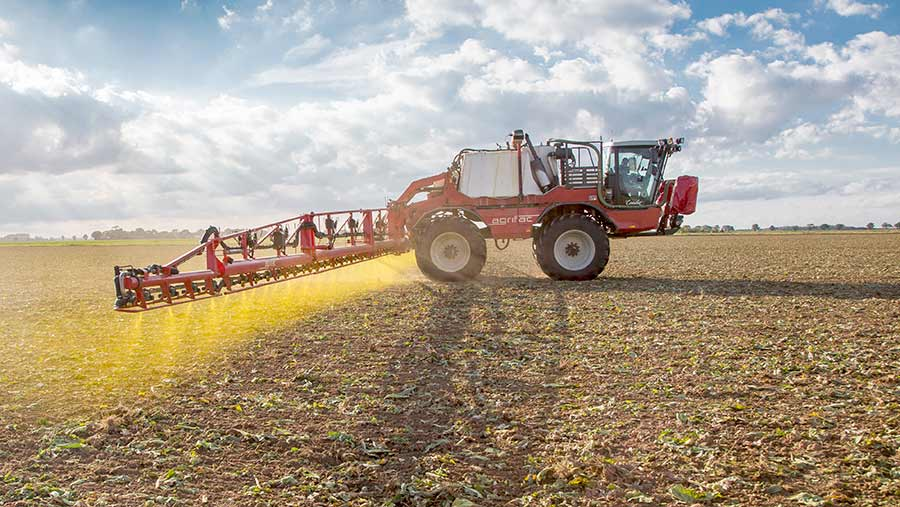 Pre-emergence herbicide being applied to a crop