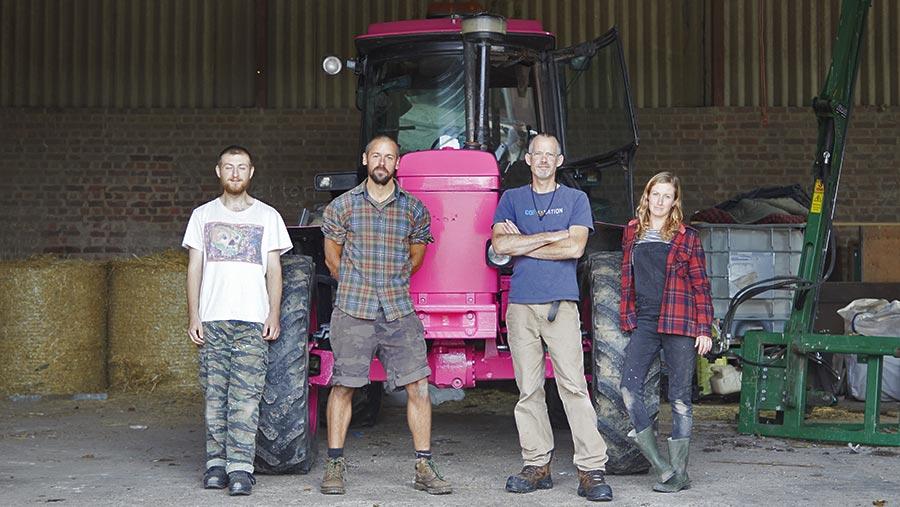 Extinction Rebellion Farmers pink John Deere tractor with group members