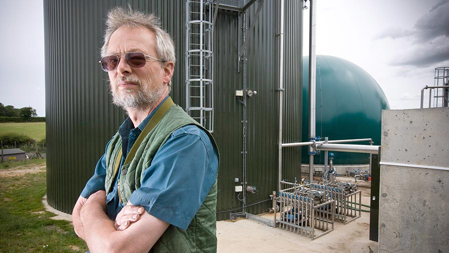 Stephen Temple in front of a digester