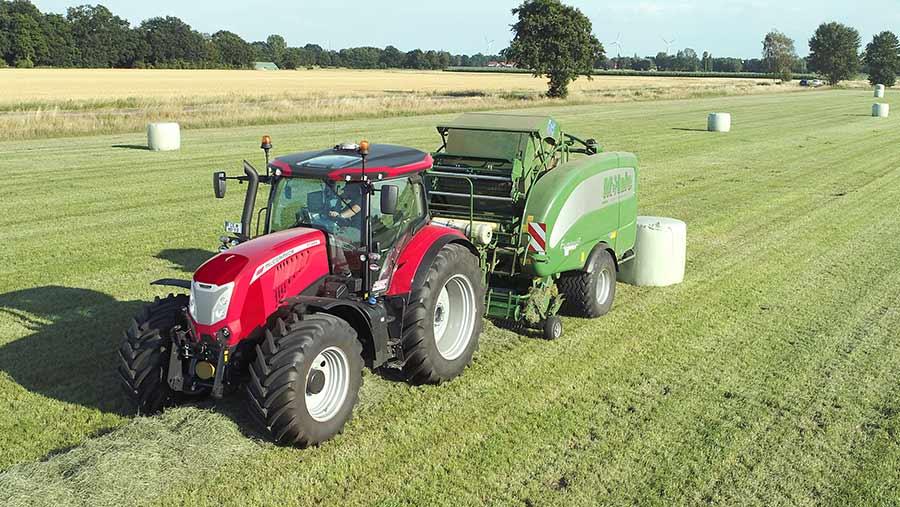 McCormick X7.6 series tractors in field pulling baler