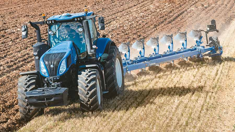 New Holland tractor with drill in field