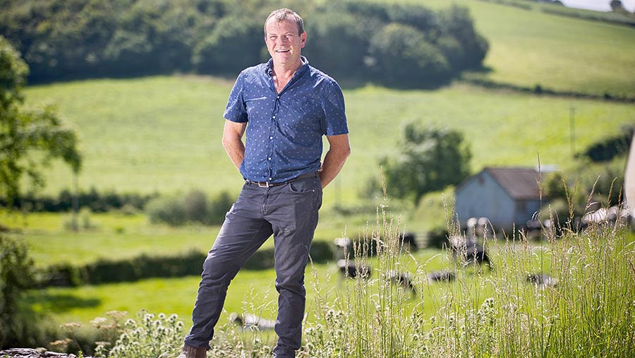 Martin Evans standing in a field