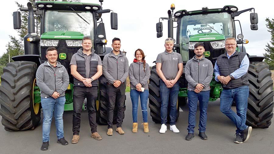 Bridgestone team in front of tractors