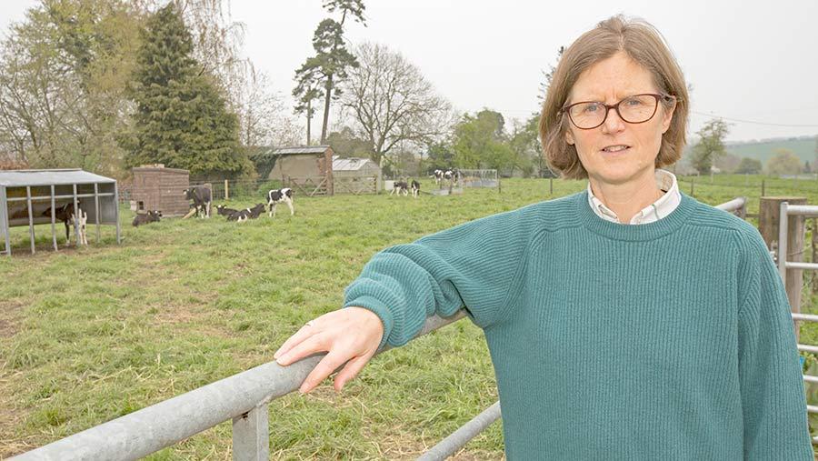 Elizabeth Birkett standing by a fence in a field