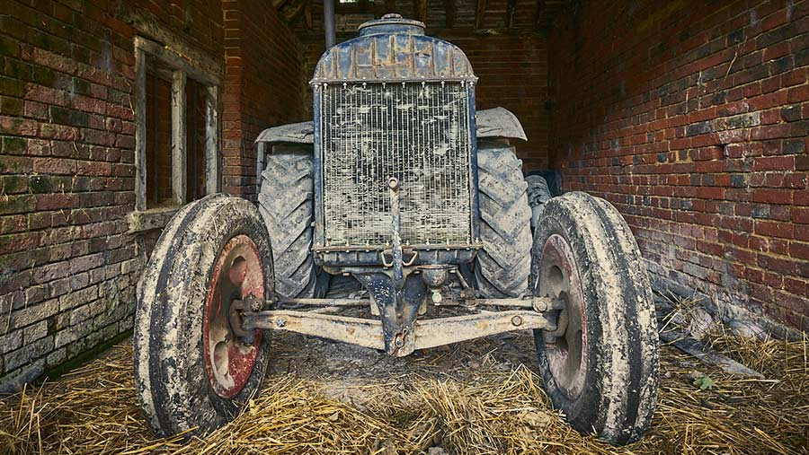 Old tractor in barn by Matthew Thomas
