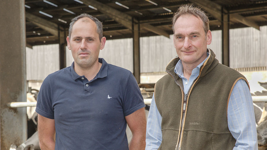 Bryn Moore(left) and Gavin Davies in cow shed