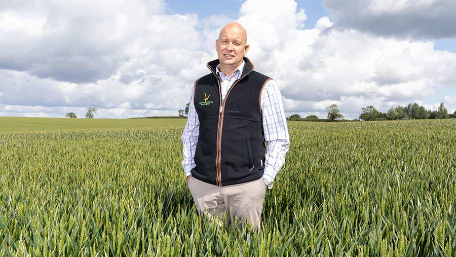 Andrew Robinson standing in a crop