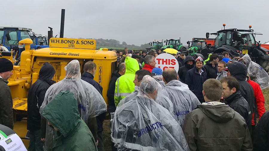 Crowd getting wet at auction