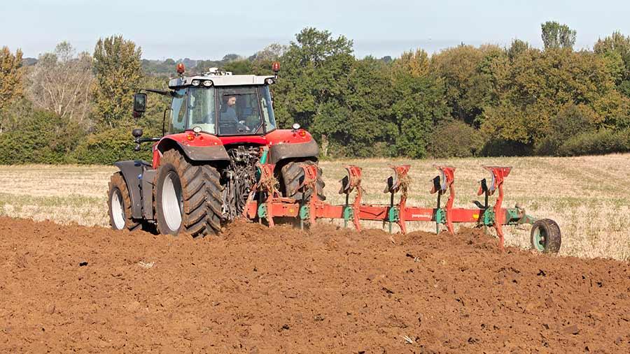 Massey Ferguson 7718 working in field