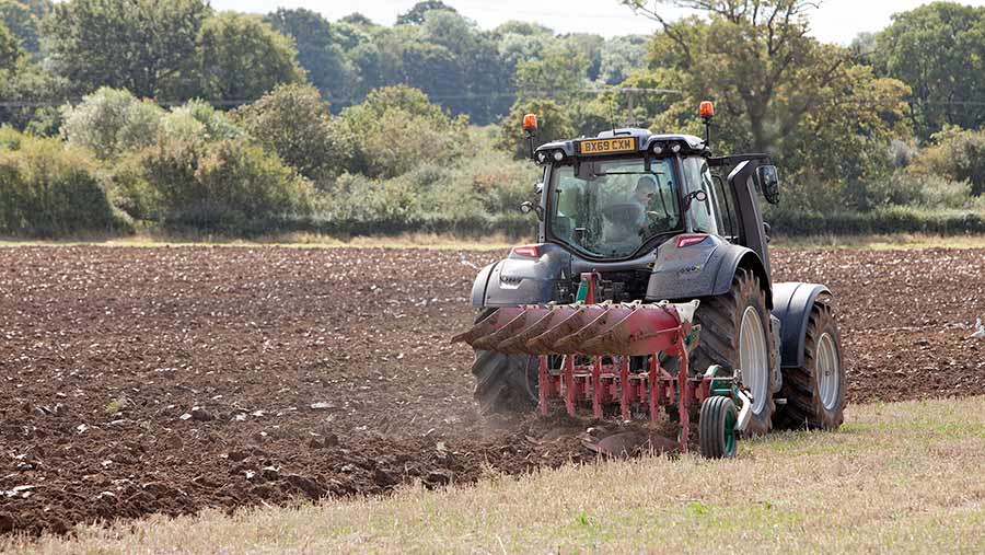 Valtra T174EV working in field